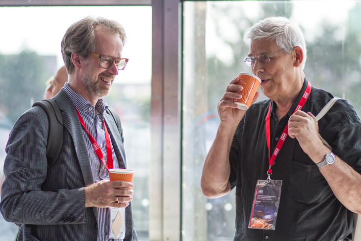 Professors Bernard Dam and Keith Ross in discussion over coffee